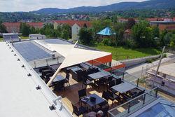 Sonnenschutz elektrisch aufrollbar