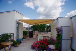 Sonnensegel als Sonnenschutz für die Dachterrasse